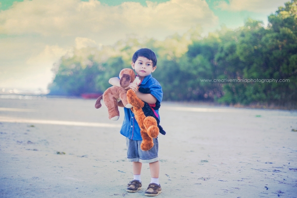 cute little boy holding a toy dog